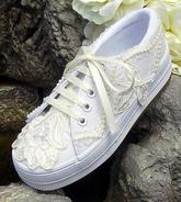 Children's ivory bridal wedding tennies with lace, pearls, and ribbon